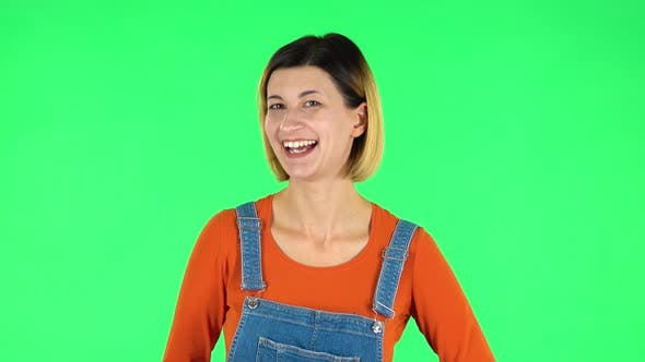 Cover Image for Girl Shows Two Fingers Victory Gesture. Green Screen