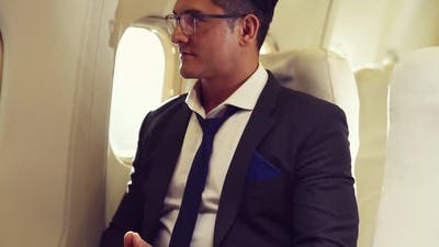 Businessman Travel on a Business Trip By Airplane