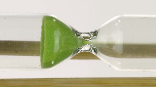Vertical Video Global Warming Deadline Green Sand Pouring in Hourglass Until End of Time