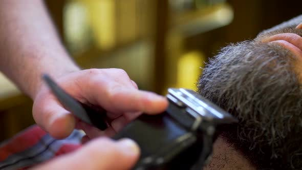 Thumbnail for Bearded Man Getting Beard Haircut and Shaved