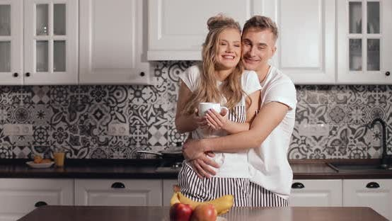 Thumbnail for Good Morning Kiss and Hug in Kitchen