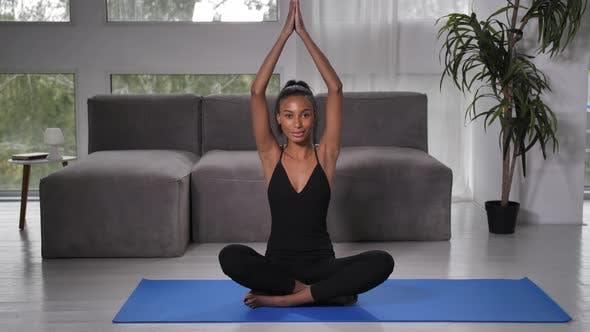 Young Female Yoga Instructor Meditating on Camera