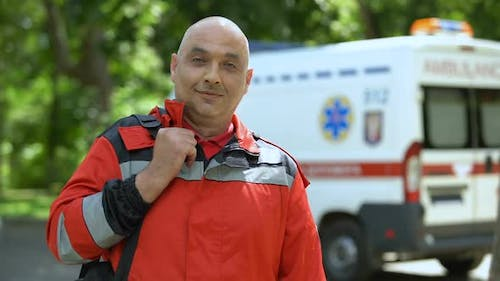 Middle-Aged Paramedic Posing for Camera, Professional Emergency Medical Service