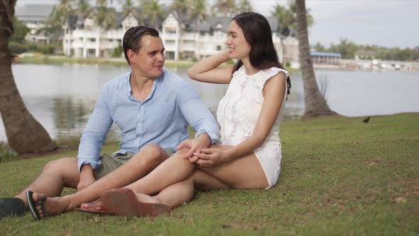 Thumbnail for Content Resting Couple Having Rest on Grass on Vacation