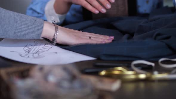 Thumbnail for Skillful Hands of Women Choosing Decor for Dress