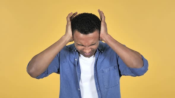 Cover Image for Young African Man with Headache, Yellow Background
