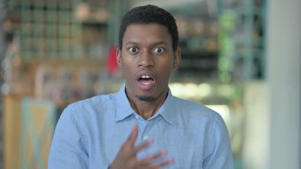 Upset Young African Man Feeling Shocked