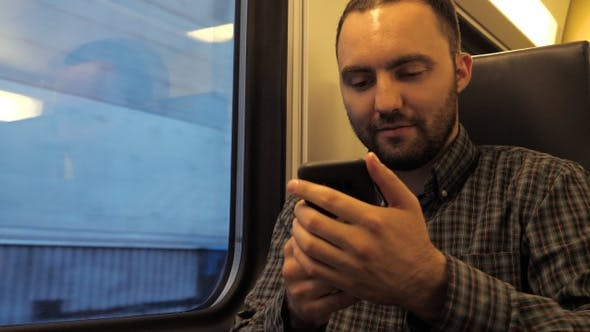 Thumbnail for Handsome Man Sitting in A Subway Train and Surfing in Web