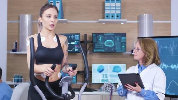 Female Scientist in Sports Research Testing Female Athlete Endurace