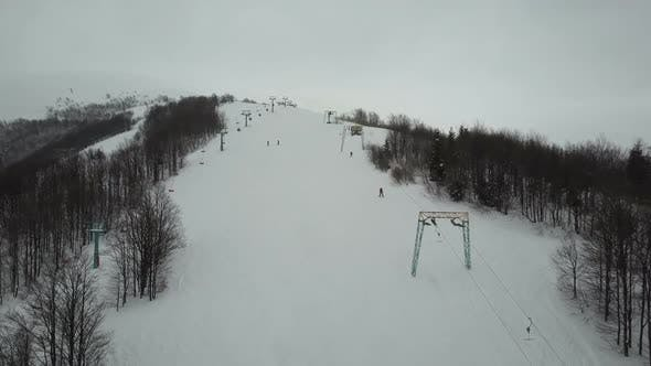 Thumbnail for Flight Over People Using Ski Lift in Mountains. Aerial View of Ski Resort