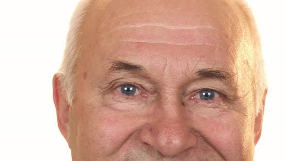 Thumbnail for Close Up of the Blue Eyes of a Cheerful Senior Man Isolated