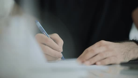 Thumbnail for Student Hand Writing Pen at Notebook. Close Up of Business Man Hand Writing Pen
