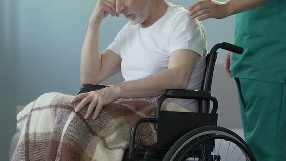 Thumbnail for Lonely Senior Man Sitting in Wheelchair at Caring Center, Waiting for Relatives