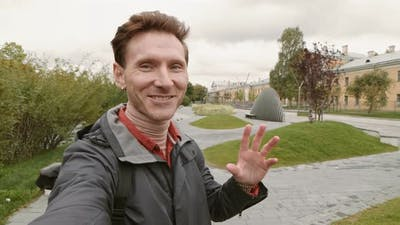 Man Filming Vlog in Public Park