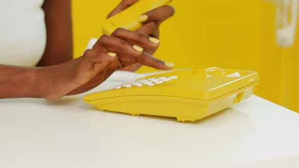 Thumbnail for Yellow Telephone In Retro Style Is Used By Black Woman