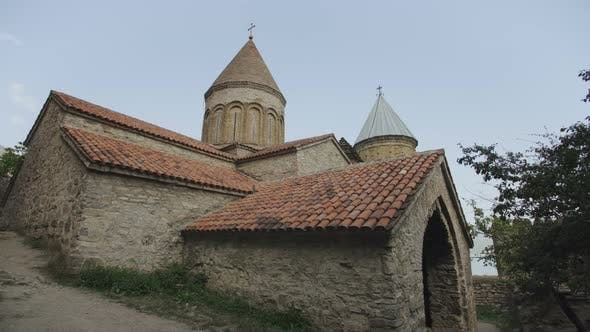 Thumbnail for Old Orthodox Church of Stone and Brick with Tiled Roof and High Towers, Highlands of Georgia
