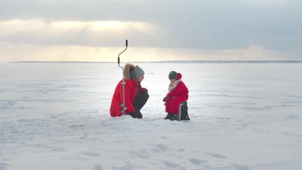 Thumbnail for Dad and Son Are Fishing in the Winter. Long Shot