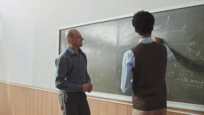 Student and Professor Solving Geometry Problem at Blackboard