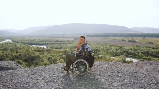 Thumbnail for Disabled Man in Wheelchair After Desease or Accident which Praying on the Hill