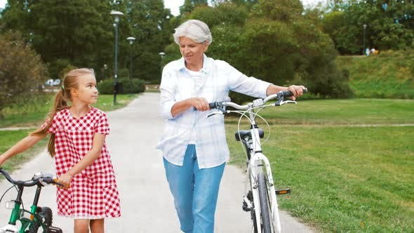 Grandmother and Granddaughter with Bicycles