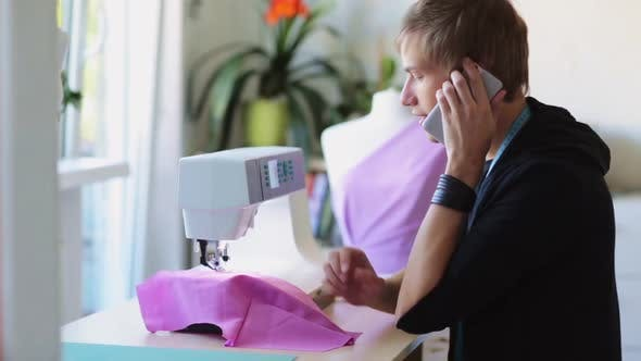 Fashion Designer with Sewing Machine Working