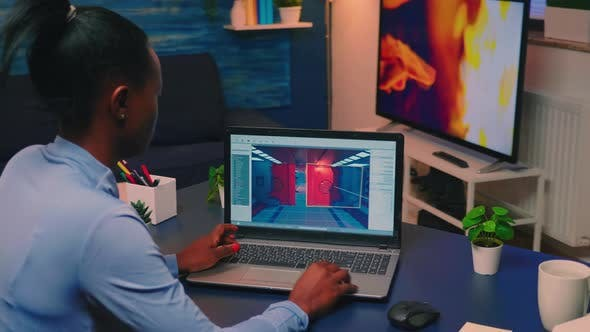 Young African Woman Gamer Testing Online Professional Game on Laptop