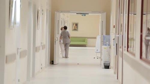 Doctor Walking Down Hospital Hallway