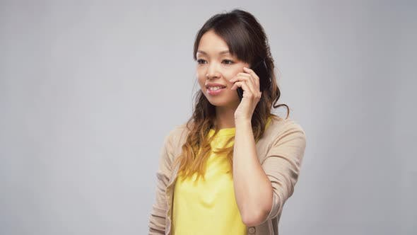 Cover Image for Asian Woman Calling on Smartphone