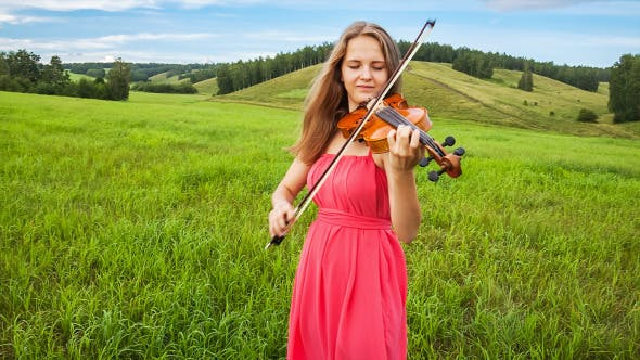 Thumbnail for Violinist Plays on a Green Meadow