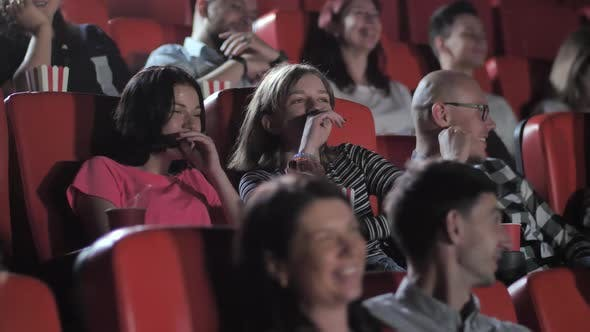 Two Teen Girls Laughing Nonstop During Funny Movie