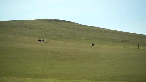 Thumbnail for Horsemen and Motorcycle in Treeless Central Asian Steppes
