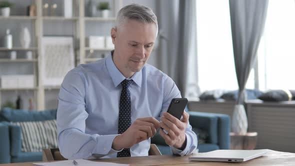 Thumbnail for Gray Hair Businessman Using Smartphone