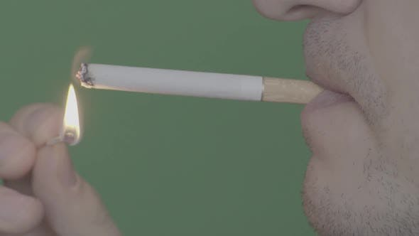 Thumbnail for Cigarette in the Mouth of a Smoker. Close-up. Slow Motion