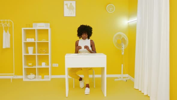 Woman Has Snack Creative Yellow Room
