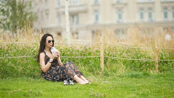Thumbnail for Cute Woman Relaxing in the Park Outdoors