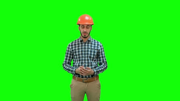Cover Image for Construction Worker Enlisting Factors for Success on a Green Screen, Chroma Key.