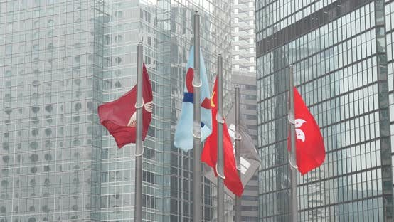 Thumbnail for China and Hong Kong flag over business office building