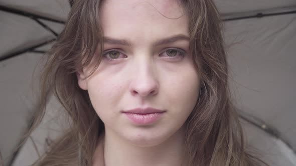 Thumbnail for Close-up Face of Gorgeous Sad Woman Crying Outdoors on Rainy Windy Day. Portrait of Beautiful
