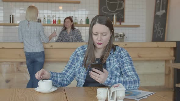 Thumbnail for Focused Freelancer Woman Working on Phone in Cafe