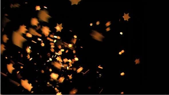 Orange stars moving against black background