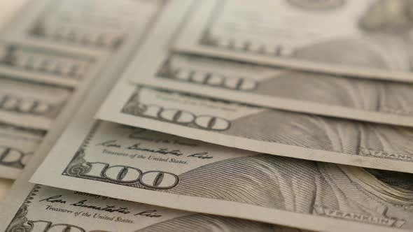 Thumbnail for USA national currency in 100 denominations 4K 2160p 30fps UltraHD tilting footage - Slow tilt over r