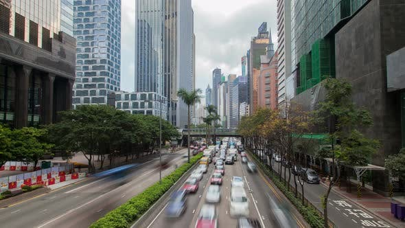 Thumbnail for Hong Kong Street with Busy Traffic and Skyscraper Office at Day