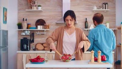 Wife Mixing Healthy Salad