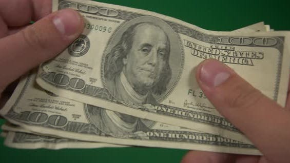 Dollars. American Money Close-up on a Green Background Hromakey . 100 Dollar Bills. One Hundred