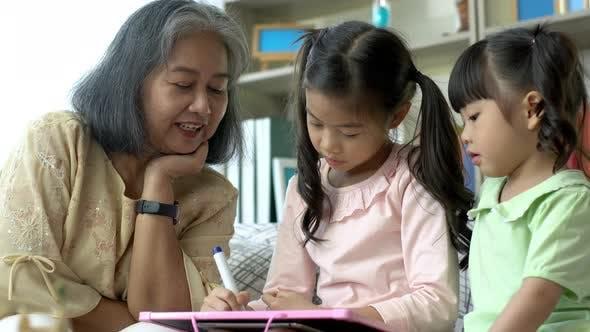 A Grandmother Teaching her Granddaughter 04