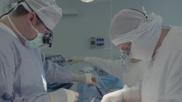Thumbnail for Medical Staff During a Heart Operation. The Surgeon Selects the Instruments