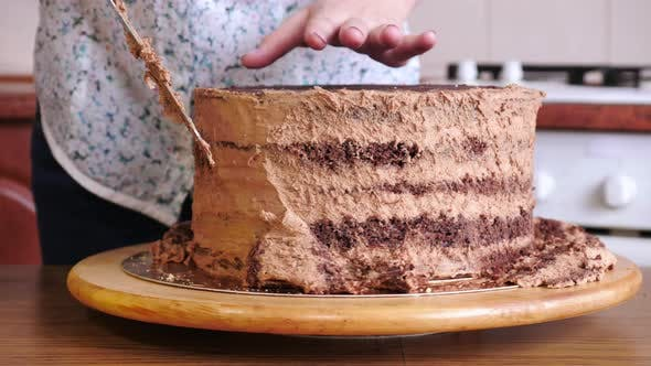 Thumbnail for One person cutting the cake edges