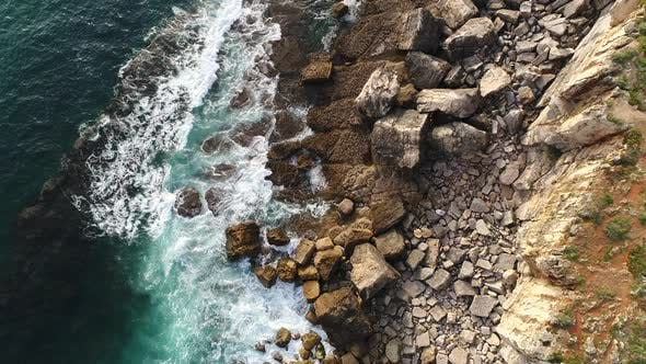 Aerial View of Raging Waves Crashing in Rock Formation Rocky Sea Coast
