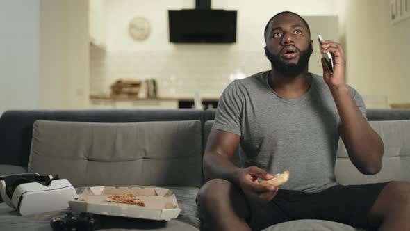 Thumbnail for Surprised Guy Watching Tv in Open Kitchen. Shocked Man Stopping with Surprise
