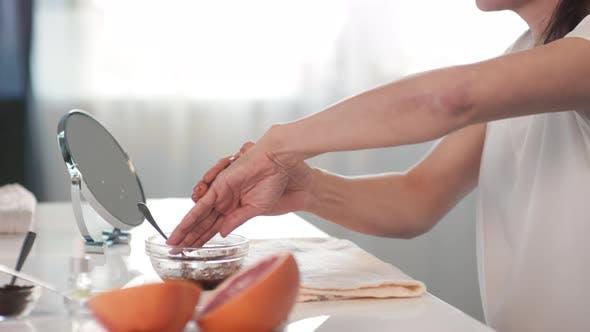Applying Homemade Coffee Scrub On Hands